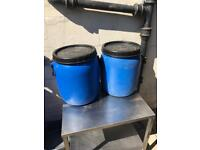 Large plastic barrels, containers, horse, poultry, wine.
