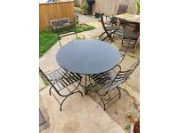 Cast iron table 4 chairs