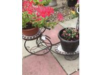 bike stand with 2 flower pots with flowers