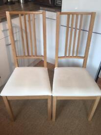 Two IKEA kitchen chairs