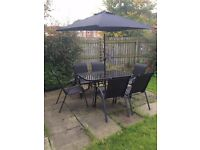 Glass top table + 6 chairs + parasol and waterproof cover