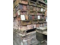 Salvage brick and large quantity of trestles for sale