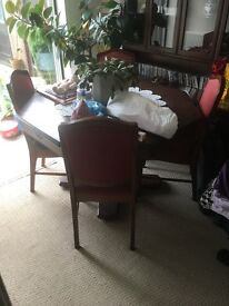 Extending dining table and matching furniture