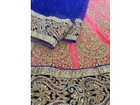 Peach and blue bridal lengha fit and flare dress with scarf.