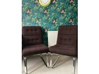 2 brown material chairs