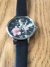 Ladies watch with a flower face and a genuine leather strap new