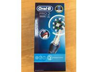 Oral-B Pro 2 Electric Toothbrush.