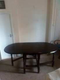 Woodern drop leaf table seats 6