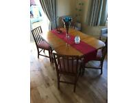 Solid oak dinning table and four solid oak chairs