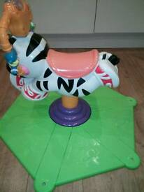 Fisher price bounce n spin zebra