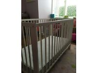Ikea cot A lovey white cot with washable mattress . Great condition