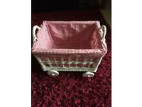 Pretty decorative wicker basket on wheels