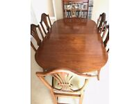 William Tillman mahogany extending Dining table and 6 chairs.