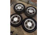 15 Inch 4 Stud Ford Fitment alloys with decent 205x 555 x R15 Tyres fitted.Taken from Mondeo