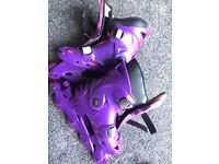 Roller blades/skates purple and pink
