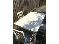 White wooden table and 4 chairs