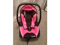 Pink/black Recaro car seat
