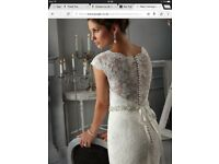 Brand new condition Mori Lee style 5268 beautiful vintage lace wedding dress. Size 12