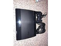 PS3 with 2 Dual Shock 3 Controllers & 21 games.