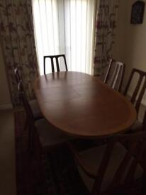 Nathan teak oval extendable table with 4 chairs and 2 carver chairs