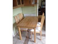 Ikea Solid Pine Table with 4 upholstered chairs