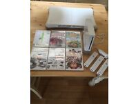 Wii console + wii fit and board + 6 games + 3 remotes