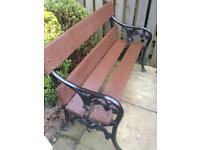 Ornate black cast iron garden bench