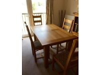 Solid oak extending refectory dining table & 6 upholstered chairs