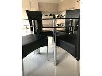 Circular 2 tier glass dining table and 4 chairs