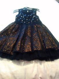 Next girls black/gold sequence party dress with black frilly underskirt size 9 years
