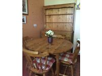 Solid Pine Dresser and Pine table with 4 chairs, will sell separately.