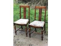Two vintage oak wooden chairs
