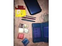Blue Nintendo DSI XL with games, case charger and stylus and original box. LIKE BRAND NEW