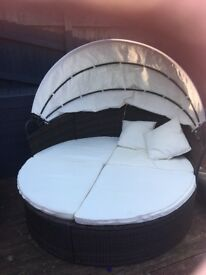 Garden day bed and table and 4 chairs. In good condition.
