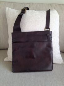 Zip top cross body bag in soft brown leather.
