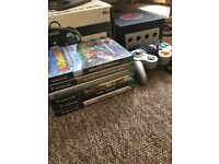 Nintendo GameCube including original box, cables, 1 silver controller and 6 quality games.