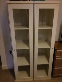 2 white book case caninets