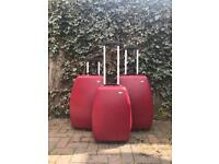 Set of 3 Red hard shell suitcases