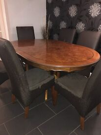 Brown Antique look table with chairs