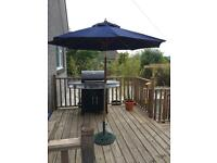 Parasol and cast iron base tilting function