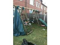 Climbing frame with swing slide see saw and tent