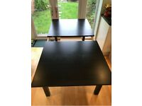 Large black extendable dining table