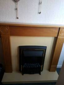 Electric fire and mantlepiece