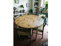 Extendable dining table with four chairs