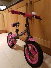 Balance bike for 3yr old. Black with pink