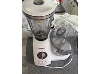 A barely-used Bosch 1100w food processor with all attachments.