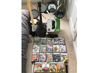 XBox 360 with Kinnect, Rock Band Drums, Lips Microphones, Controllers and Games