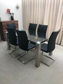 Glass and stainless steel modern dining table and 6 chairs. Excellent condition. 160cm x 90cm