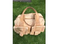 Tan leather Storksak baby changing bag