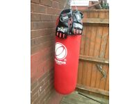 Punch bag and MMA gloves